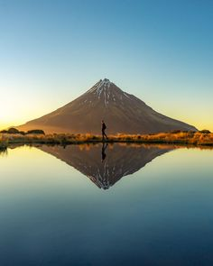 Mt Taranaki is one of the 15 best places to visit in New Zealand. Want to see the other 14? Then don't visit New Zealand until your read this New Zealand travel guide. You'll also get ideas for cities to add to your itinerary, tips on where to stay in each place and tours in New Zealand. #travel #NewZealand #NZ #traveltips #newzealandtravel #bucketlistideas