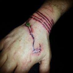 Fishing hook tattoo
