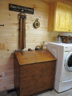 I actually HAVE an old wood grain bin like this and was wondering what I should do with it....laundry hamper