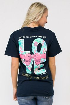 """Let all that you do be done in love"" tee from Simply Southern. Short sleeve tee with a saying on graphic on the back and a Simply Southern logo on the front. Perfect for any occasion. Material is 100"
