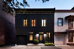 Photos by Adrien Williams via Designboom. Nope, that's not a movie villain's lair, though the facade is, admittedly, a bit foreboding. This 125-year-old two-story residence in Montreal got a...