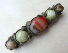 A lovely faux agate art glass bar brooch manufactured under the trade name Miracle by A Hill and company Ltd The brooch has a large central faux Glass Jewelry, Jewelry Rings, Jewellery, Vintage Brooches, Vintage Jewelry, Glass Bar, Modern Jewelry, Celtic, Agate