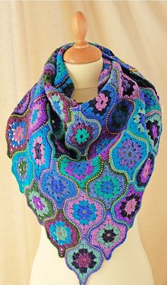 Ravelry: Mystical Lanterns Shawl pattern by Jane Crowfoot, crochet (The kit provides 13 colors, one skein each, of Jamieson's Spindrift, and is available in four color-ways: Aurora, Storm, Mistral, and Monsoon,)