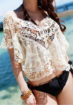 Black bikini-clad model with crochet lace top