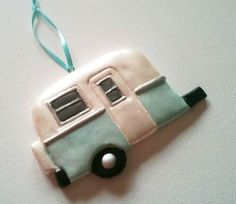Untill I can convince (bully) my family into buying one of these, I suppose I'll add this to my Christmas list this year :)    Vintage Travel Trailer Ornament by circa76designs on Etsy, $15.00