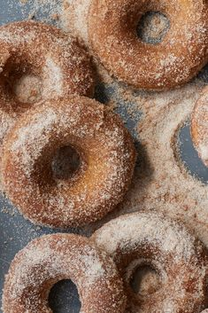 Baked Apple Cider Doughnuts Recipe - NYT Cooking -Reduce apple cider to needed amount --> reduce sugar in donut -if making 1 batch, only use melted butter, sugar, tsp cinnamon for coating -add cardamom to coating Apple Cider Doughnut Recipe, Baked Apple Cider Doughnuts, Baked Donuts, Donut Recipes, Baking Recipes, Dessert Recipes, Desserts, Doughnut Pan, Baked Apples