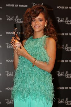 The Red/Brown Side-Swept Curls | 26 of Rihanna's Best Hair Moments #riri #rihanna