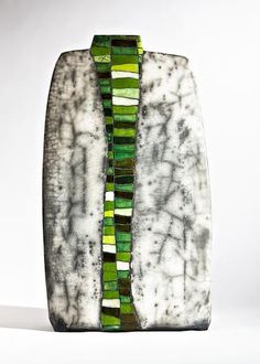 """""""Zwei Welten"""" vase Ute Grossman was born in Dresden ,Germany in 1960. Having originally studied Chemical Engineering, she gravitated towards the arts with studies in painting and graphics at the Academy of Fine Arts, Dresden in 1998/1999. She became a member of the Association of Artists as a freelance ceramicist in 2003 and has since developed a considerable portfolio of ceramic vessels and sculptural objects. Her early work also involved doing mosaic sculptures in public places."""