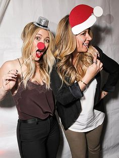 Hilary Duff gets into the holiday spirit on December 16, 2013 with sister Haylie for Lea Michele's SodaStream-sponsored Chrysalis Shopping Event at the Beverly Hills Switch Boutique.