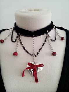 Check out this item in my Etsy shop https://www.etsy.com/pt/listing/265028725/stiched-heart-choker