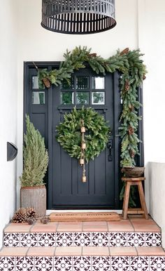 Holiday Home Tour: This Dreamy Space Proves That White Is Actually the Most Festive Color Step Inside a Dreamy, Minimal Holiday Home Front Door Christmas Decorations, Christmas Porch, Farmhouse Christmas Decor, Front Door Decor, Christmas Love, Winter Christmas, Christmas Wreaths, Christmas Front Doors, Outdoor Christmas Tree Decorations