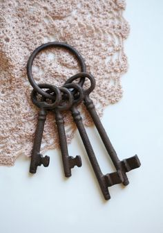 """This set of cast iron keys will add a touch of antique charm to your decor.   8"""" long  $8.99"""