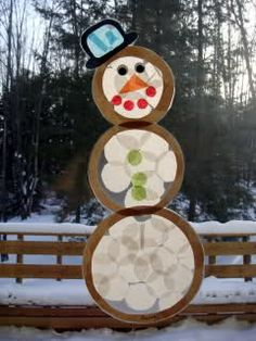 Winter crafts: contact paper, tissue paper and construction paper.
