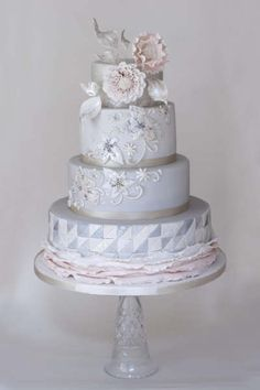 Mother of Pearl | Wedding Cake with sugar flowers, silver leaves and pink ruffles