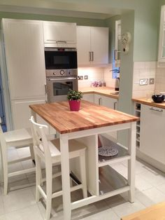 butcher block island. Perfect but with stools and seating on both sides