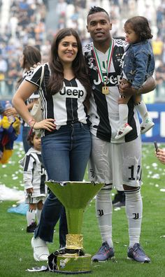 Alex Sandro of Juventus FC and family celebrates with the trophy after winning the Serie A Championship at the end of the serie A match between Juventus and Hellas Verona FC at Allianz Stadium on May 2018 in Turin, Italy. Own Goal, Turin Italy, As Roma, Juventus Fc, Cristiano Ronaldo, Sandro, Verona, Gym Workouts, Football
