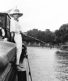Audrey Hepburn in Funny Face (1957) fishing on the Seine from a French canal barge