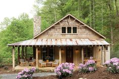 The rustic exterior of the Whisper Creek plan is perfect for enjoying the mountain views