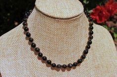 "This 6mm Round Gold Obsidian Gemstone Beaded Necklace is 12"" long. This necklace is hand knotted next to each bead, to ensure safety for small children in case the necklace were to break. The Loop Tog"