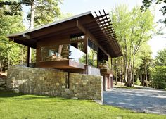 "From its locally quarried stone foundation to its zinc-coated copper roof, the cottage was inspired by its surroundings. ""We talked a lot with our client about what the materiality would be,"" says architect Karen Stonely, who, citing the organic style of Bar Harbor architect Robert Patterson, designed the structure with wood rather than drywall."