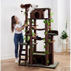Give your cats a taste of the wild with this amazing climbing cat tree house. It is truly a challenge for cats. Cool Cat Trees, Cool Cats, Cat Tree House, Cat Towers, Cat Condo, Cat Furniture, Ladder Bookcase, Ladder Decor, Climbing