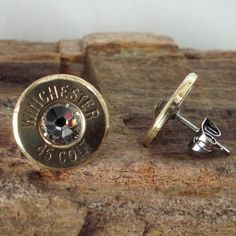 Glacier - Colt 45 - Ultra Thin - Bullet Earrings. Guns scare me but these are SICK!