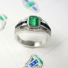 Bespoke emerald centre-stone ring, set in silver band