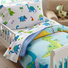 Prehistoric fun! Our Dinosaur Land comforter/quilt has rows of adorable dinosaurs roaming across the bed. Each of the dinosaurs are outline stitched. Super soft all cotton! Back is solid.