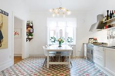 eat-in kitchen, clean, white, busy floor tiles, large print and shelves. Kitchen Interior, Kitchen Design, Interior Styling, Interior Design, Interior Ideas, Happy Kitchen, Nice Kitchen, Beautiful Kitchen, Kitchen Ideas