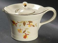 Hall China Melody shape teapot in Autumn Leaf pattern (pattern made for Jewel Tea Co. from 1930s-1978) of fall leaves decoration w/ gold trim on rim of lid and body, ceramic, USA