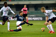 Alessio Cerci (L) of Hellas Verona competes with Filip Victor Helander of Bologna FC during the Serie A match between Hellas Verona FC and Bologna FC at Stadio Marc'Antonio Bentegodi on November 20, 2017 in Verona, Italy.