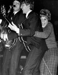 Oct. 26, 1963 A very excited Beatle-maniac (obviously an early Harrison Scruff lol) hugs George Harrison onstage while he and The Beatles perform at a pop festival in Stockholm, Sweden  Lucky gal….