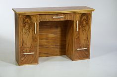 A beautifully worked hand-veneered desk - one of the pieces completed by a student during his 2012-13 nine-month course.