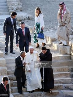 Pope Francis (Bottom-C), King Abdullah II of Jordan (C-L), Queen Rania (Top-C), Jordan's Crown Prince Hussein (Top-L) and King Abdullah II's religious affairs adviser (Top-R) take part in a visit of Bethany, a site on the eastern bank of the River Jordan where some Christians believe Jesus was baptised, on May 24, 2014. Pope Francis called for fresh peace talks on Syria, urging all sides to swap arms for negotiations to bring an end to the three-year civil war there.