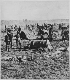 "General Crook's field headquarters at Whitewood (Dakota Terr.) during the ""Horsemeat March"" of 1876 in pursuit of a band of Sioux fleeing General Custer's defeat at the Battle of Little Big Horn. After the battle of Slim Buttes, the Sioux burned the grass, and the American cavalry rode with reduced rations to allow faster pursuit; the cavalry had no food for men or horses, and the soldiers eventually had to shoot and eat their horses."