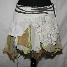 Stunning skirt is a collage of fabric. A cool ragged-look option for layering for under the leather jerkin/mini-dress dealio, with tights or hosen?