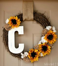 Get personal! Paint a wooden letter with a brightly colored hue and accent it with your favorite flowers, burlap rosettes, and cotton clusters for a fall-ready wreath.