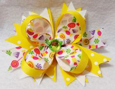 4.5 Inch Boutique Hair Bow in Yellow Polka Dot and Candy Print Grosgrain Ribbon, White Loopy Bow, a Pinwheel Base and Faceted Gem Center Embellishment. All my hair bows feature a covered and lined no-