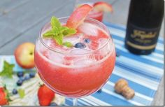 Strawberry nectarine and lime bellini 6 strawberries 1.5 nectarines (use other half for garnish) handful of blueberries juice of half a lime ½ cup water ½ cup sugar handful of mint leaves club soda champagne