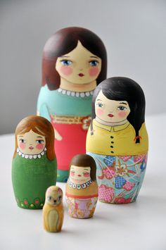 The smallest one is a pet cat.  Pastel Muniecas nesting dolls  OOAK by munieca on Etsy, $85.00