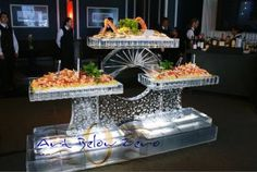 Shrimp cocktail and oysters on an ice sculpture