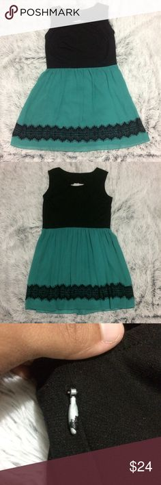 Fun and Flirty Cut-Out Dress Fun and flirty En Focus dress with cut out back. True to size. Comfy and stretchy material on top and gorgeous, lightweight seafoam green skirt with black lace detail. Armpit to armpit is 19 inches, waist is 34.5 inches, and length is 36 inches. Only worn once, but the black has started to wear off of the zipper. Dresses Midi