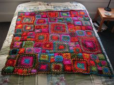 layout of the Babette Blanket, but with basic granny squares - completely cauchy