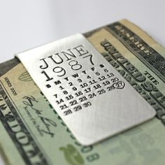 """The original hand stamped calendar as a money clip...what a great way to commemorate a special day! Perfect for any big date!  This 1"""" wide, 20 gauge solid sterling silver, hand forged money clip will be hand stamped with ANY month from ANY year (past, present or future), and then one day will be highlighted with an oval or a heart AROUND the date."""