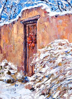 An old adobe wall and gate, after a snow storm, in Santa Fe, New Mexico.
