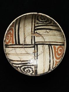 Bowl of red lead-glazed earthenware, painted on a white slip and covered with a clear glaze, Samarkand, 9th century or 10th century.