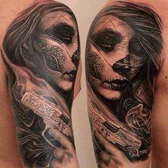 Dia De Los Muertos face paint with gun tattoo. Incredible work