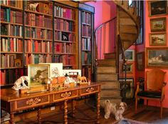 I have literally dreamed about a library like this! One with rich mahogany, a spiral staircase, and books lining the walls two stories high. There is also a gorgeous crushed velvet chaise lounge in my dream, but unfortunately not in this picture.