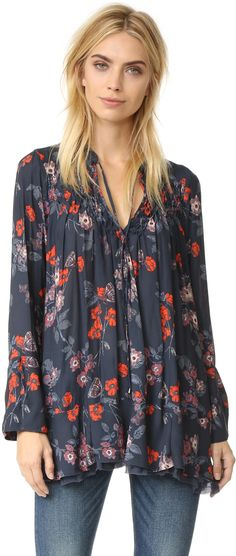 Free People So Fine Smocked Printed Tunic  Smocked pleats accents the yoke of this flowing, patterned Free People tunic. A raw-edged chiffon ruffle accents the hem and slim ties secure the neckline. Long sleeves and split cuffs.  affiliate link