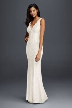 Wearing a classic sheath lace wedding dress means you can accessorize to make the look your own. Complement the scalloped lace hem and V-neckline with jewels and a sparkling headpiece for a completely custom look.  DB Studio, exclusively at David's Bridal  Lace  Back zipper; fully lined  Dry clean  Crafted in China Protect your dress for years to come with our Wedding Gown Preservation Kit.